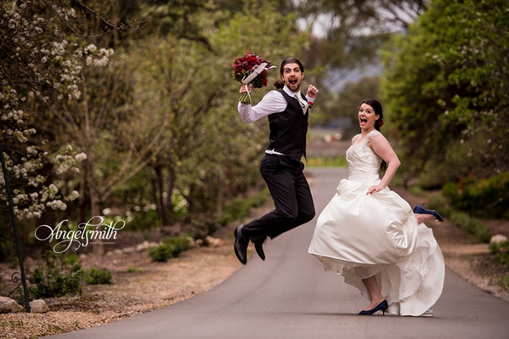 Miranda and Luke jumping at Lyndoch Hill on their wedding day